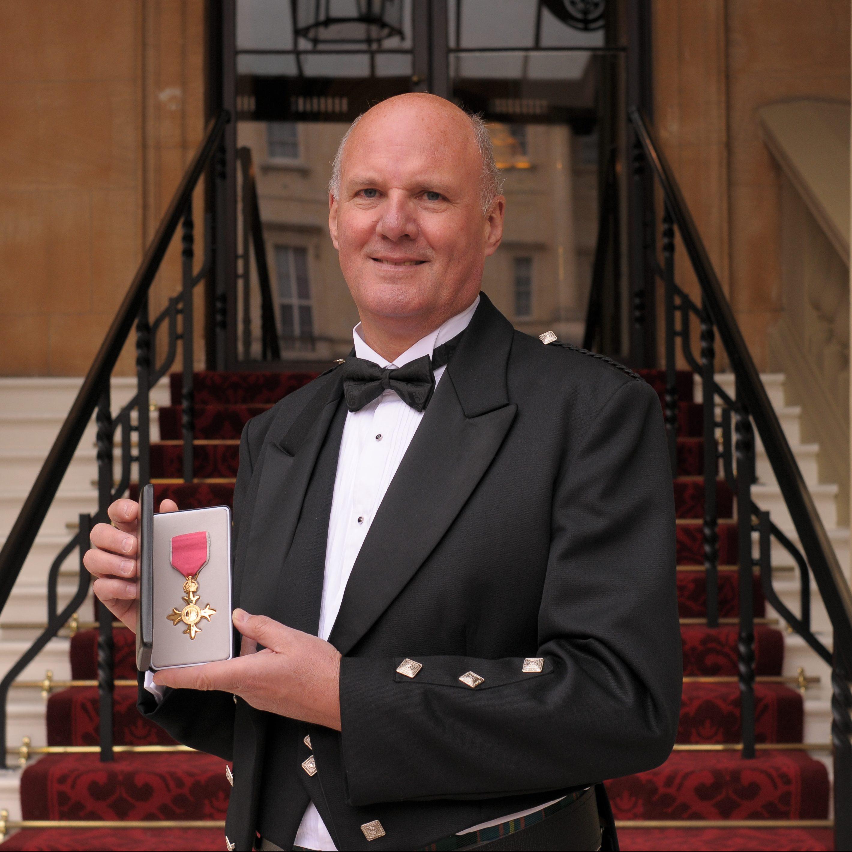 Donald Cameron receives his OBE at Buckingham Palace